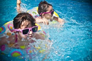 Children enjoying in the community pool