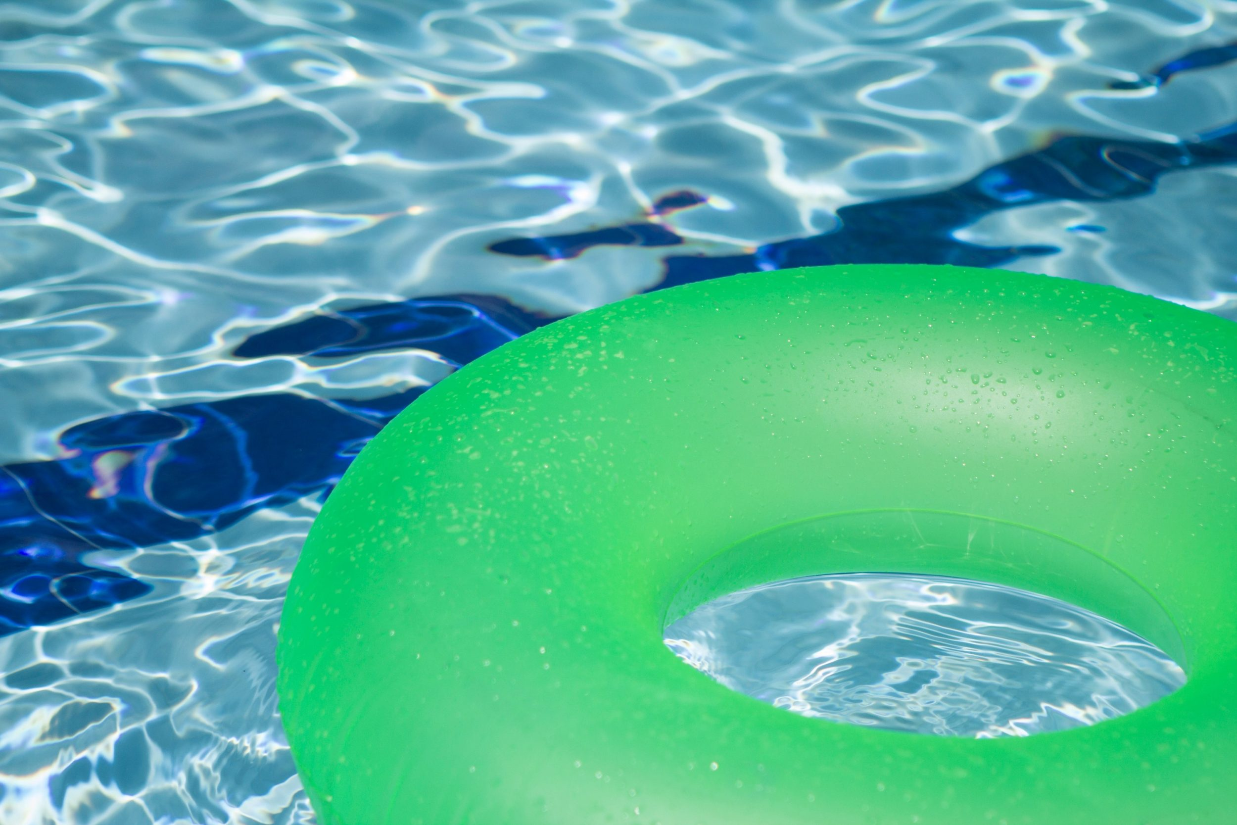 green floater on the pool